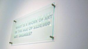Statements (2013), BFAMFAPhD / Caroline Woolard, plexiglass, plaque hardware. CC-BY-ND 4.0