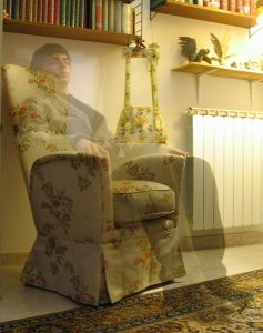 "Photo of Niccolò Caranti. ""A supposed ghost sitting on a chair"". by Terrasque CC-BY-SA 3.0"