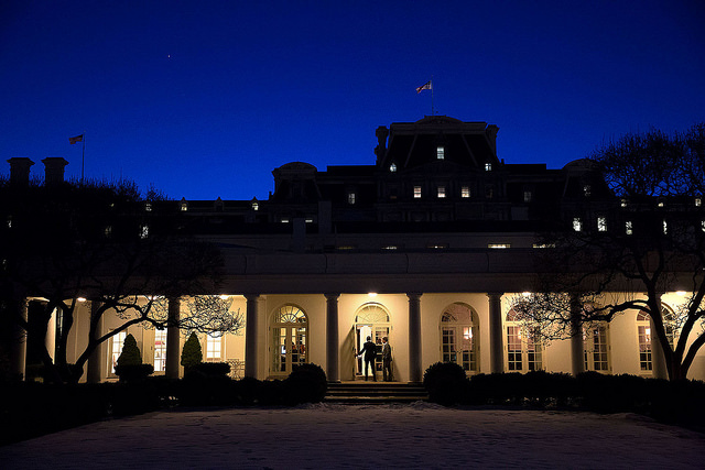 "Chuck Kennedy captured this scene at dusk as the President entered the Outer Oval Office with Shaun Donovan."" (Official White House by Chuck Kennedy) United States Government Work"
