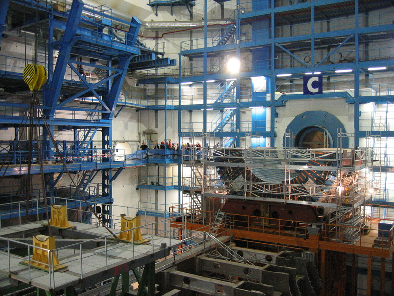 ATLAS experiment detector under construction in October 2004 in its experimental pit; the current status of construction can be seen on the CERN website.[1] Note the people in the background, for comparison. Nikolai Schwerg CC BY-SA 3.0
