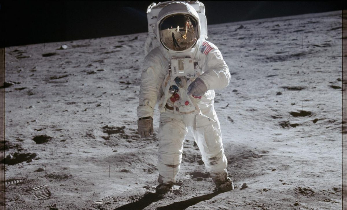 Astronaut Edwin Aldrin walks on lunar surface near leg of Lunar Module